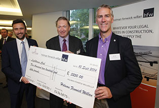 Michael and Max presenting a royalties cheque to Bill Hill, CEO, the Lighthouse Club