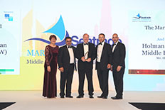 (L-R) Yaman Al Hawamdeh, Hugh Brown, Simon Cartwright accept HFW's  Seatrade award.