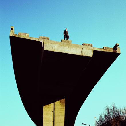 Businessman on the edge of a bridge